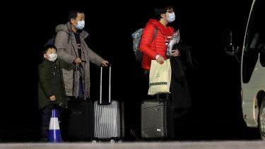 Australians evacuated from Wuhan arrive on Christmas Island on Thursday.