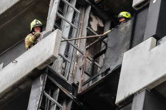Firefighters inspect the damage at Melbourne's Neo 200 building.