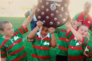 Keaon Koloamatangi lifts the Tommy Bishop Shield in 2005 with Cameron Murray (left).