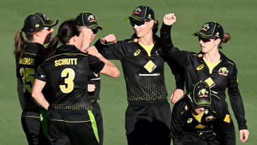 Australia celebrate victory over New Zealand at Allan Border Field on Saturday.