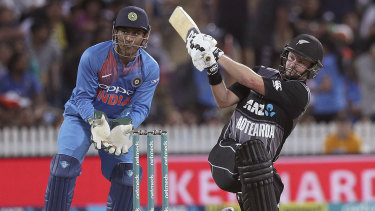Clean strike: India's wicketkeeper MS Dhoni watches on as Colin Munro hits a four at Seddon Park in Hamilton.