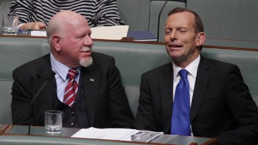 Dr Mal Washer (left) lobbied his party, under then-opposition leader Tony Abbott, to support the plain packaging rules.