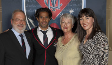 Melbourne supporter Penny Mackieson (right), who sponsored former Demon Aaron Davey (second from left).