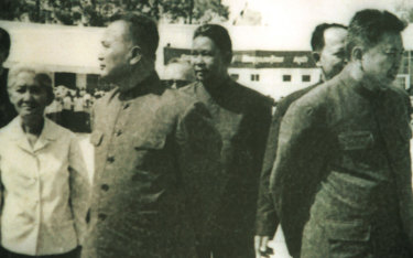 Khieu Ponnary, left, first wife of late Khmer Rouge leader Pol Pot, is seen here in this undated photo of the top leaders taken at Phnom Penh airport during the brutal 1975-1979 regime.  From left to right; Khieu Ponnary, Nuon Chea, Vorn Vet,  Ieng Sary (partially hidden) and Pol Pot.