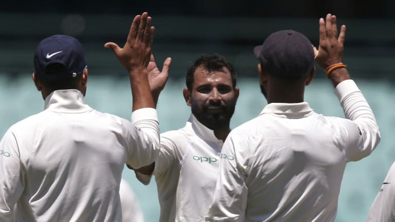 High five: Mohammed Shami, second left, celebrates after taking a wicket in Sydney on Friday.