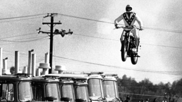 Evel Knievel jumps over 10 Mack trucks, but could he clear the gulf between economic rhetoric and reality?