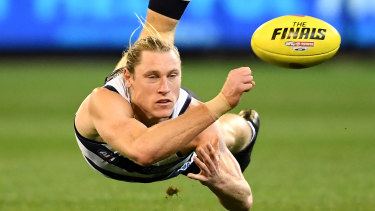 Handy option: Versatile Mark Blicavs is happy to slot into a defensive role for the Cats.