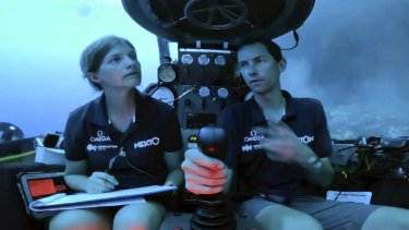 An image taken from a video issued by Nekton shows another crew: Lucy Woodall, Nekton Mission principle scientist alongside pilot Randy Holt inside a submersible 60 metres below the surface of the Indian Ocean.