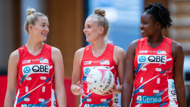 Lauren Moore, Maddy Turner and Sam Wallace in the new uniforms. The dress features a yellow bird on the shoulder to symbolise the original Sydney Swifts era.
