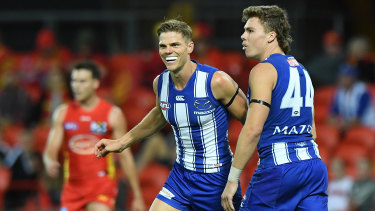 On point: Mason Wood (centre) showed glimpses of top form for the Roos during loss to the Suns.