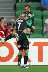 Besart Berisha celebrates with Alessandro Diamanti after scoring.
