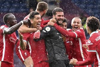Liverpool's goalkeeper Alisson Becker celebrates after scoring the winning goal.