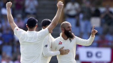 Moeen Ali (right) celebrates the wicket of John Campbell.