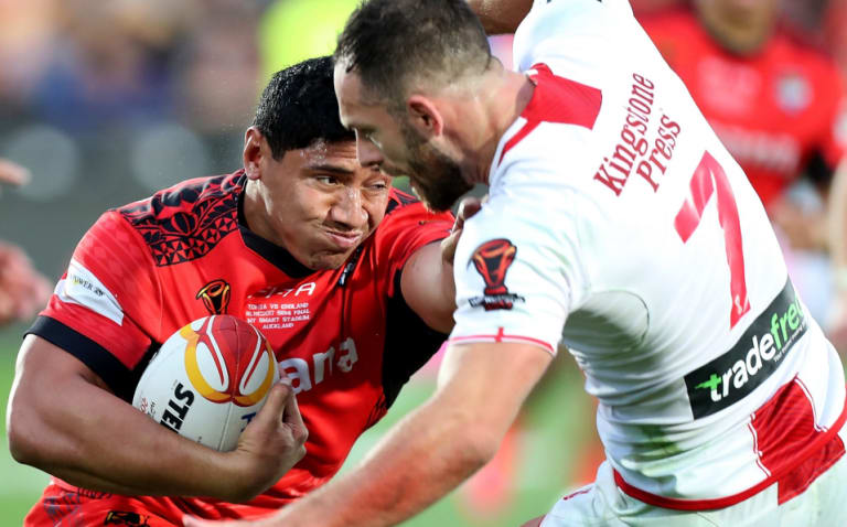 Don't argue: Jason Taumalolo shoves England halfback Luke Gale out of the way.