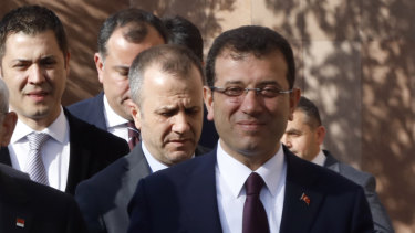 Ekrem Imamoglu, the main Turkish opposition Republican People's Party candidate for Istanbul, right, arrives to address supporters in Ankara in April.