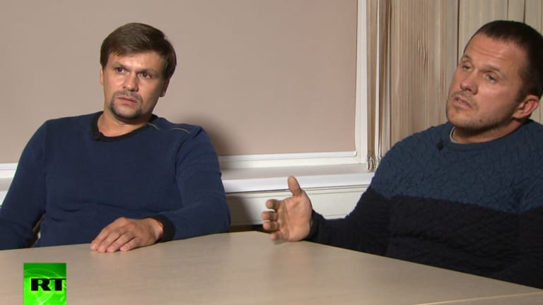In this video grab provided by the RT channel , Ruslan Boshirov, left, and Alexander Petrov attend their first public appearance in an interview with the Kremlin-funded RT channel in Moscow, Russia.