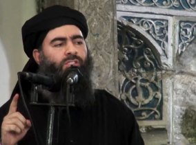 An image made from video posted on a militant website in 2014 purports to show Abu Bakr al-Baghdadi delivering a sermon at a mosque in Iraq.
