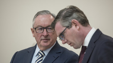 NSW Health Minister Brad Hazzard and NSW Treasurer Dominic Perrottet in Sydney on Thursday.