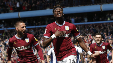 Advantage: Tammy Abraham celebrates Aston Villa's second goal against West Brom.