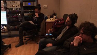 Tyler Gillett (far, right, in glasses) and PJ Vogt (wearing headphones) recreating the song in United Recording Studios, Los Angeles.