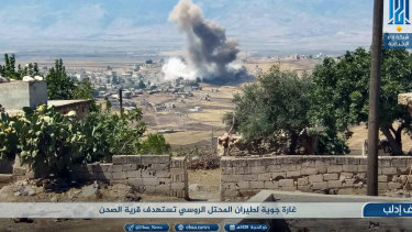 Smoke rising over buildings that were hit by airstrikes, in al-Sahan village, Idlib, Syria, on Tuesday.