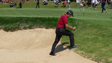Day to forget: Byeong Hun An trudges out of the bunker on the eighth.