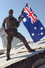 An Australian special forces operator at al-Asad airbase in Iraq's Anbar Province during Operation Okra.