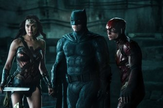 Gal Gadot, Ben Affleck and Ezra Miller in a scene from the original Justice League.