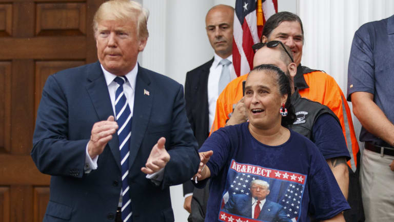 President Donald Trump is cheered by members of Bikers for Trump and supporters on  Saturday at the clubhouse of Trump National Golf Club in Bedminster, New Jersey.