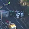 Lengthy delays on Warrego Highway after grain truck rollover