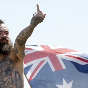 A protestor at a recent rally in St Kilda, which has thrown the spotlight on the far-right movement in Australia.