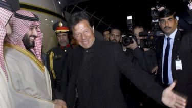 Pakistani Prime Minister Imran Khan, centre, greets Saudi Arabia's Crown Prince Mohammed bin Salman, left, upon his arrival at Nur Khan airbase in Rawalpindi, Pakistan, on Sunday.