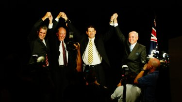 Deputy Prime Minister John Anderson, State Deputy Opposition leader Bob Quinn, state National Party leader Lawrence Springborg and Prime Minister John Howard saluting the party faithful at the 2004 campaign launch.