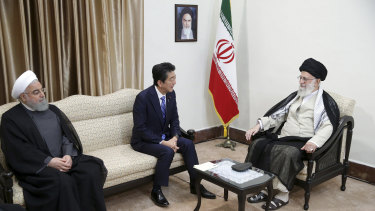 Japanese Prime Minister Shinzo Abe, centre, meets with Iran's Supreme Leader Ayatollah Ali Khamenei in Tehran on Thursday. Iranian President Hassan Rouhani is at left.