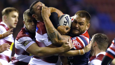 Sydney Roosters' Jared Waerea-Hargreaves charges the ball up against Wigan.