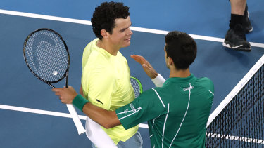 Djokovic beat big-serving Raonic to book a semi-final showdown with Federer.