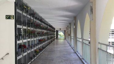 Burial plots face verandahs at the vertical cemetery.