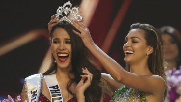 Catriona Gray of the Philippines reacts as she is crowned the new Miss Universe 2018 by Miss Universe 2017 Demi-Leigh Nel-Peters.
