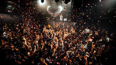 Hearts and glitter rain on the crowd at Mark Ronson's Club Heartbreak.