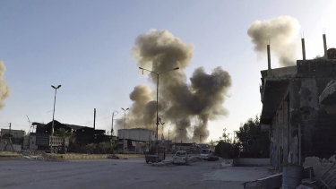 Smoke rises after Syrian government airstrikes on Douma, in eastern Ghouta on Saturday.