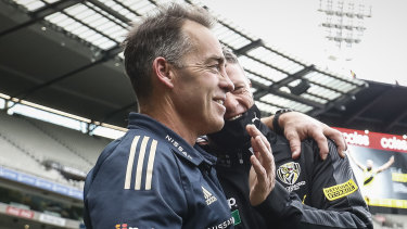 Alastair Clarkson and Damien Hardwick embrace after a dramatic draw.