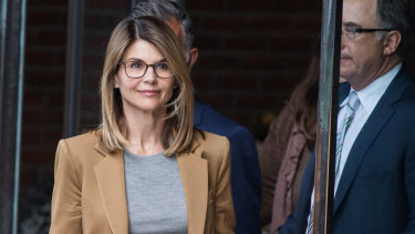 Actress Lori Loughlin leaves court after facing charges in the college admissions scandal.
