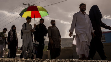 Zaheer Zindani, far right, and his friend Kitab marching outside Ghazni last month.