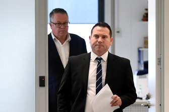 A-League boss Greg O'Rourke flanks FFA chief executive James Johnson as he prepares to enter Tuesday's press conference.