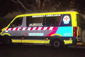 An ambulance at a Northcote house where a woman is believed to have died with COVID-19 in August.