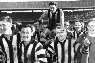 Teammates carry Weideman off after Collingwood's victory over Melbourne in the 1958 VFL grand final.