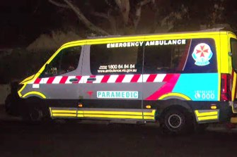 An ambulance at a Northcote house in August, where a woman is believed to have died with COVID-19.
