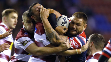 Sydney Roosters' Jared Waerea-Hargreaves is tackled during the bruising clash with the Warriors in Wigan.