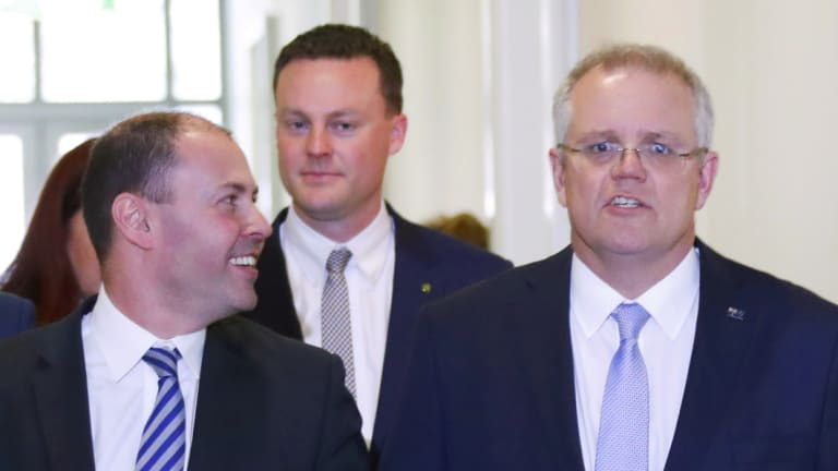 Treasurer of Australia Scott Morrison, right, walks with deputy Josh Frydenberg
