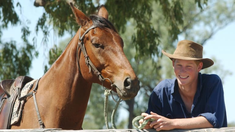 A young Prince Harry with his horse, Guardsman, during his gap year visit to Queensland in 2003.